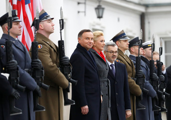 Polish President Andrzej Duda and his wife Agata Kornhauser-Duda wait for U.S. Vice President Mike Pence and his wife Karen outside Belvedere Palace in Warsaw