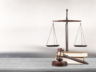 Justice Scales and books with wooden gavel on table. Justice concept