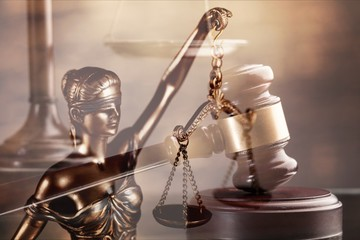 Wooden judge gavel on blurred background close-up view