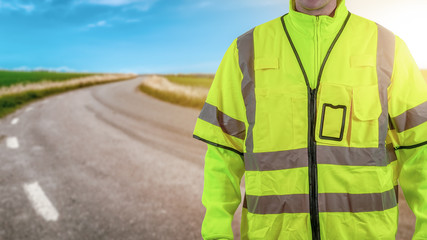 Worker with high visibility reflective safety clothes. Road work and safety concept. Plenty of copy space for your own text or product.