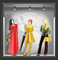 Female mannequins in bright autumn clothes.