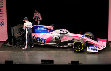 SportPesa Racing Point F1 Team drivers Sergio Perez and Lance Stroll unveil their team's new car livery at the pre-season launch event at the Canadian International AutoShow in Toronto