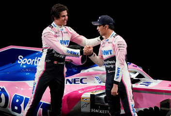 SportPesa Racing Point F1 Team drivers Sergio Perez and Lance Stroll react after unveiling their team's new car livery at a pre-season launch event at the Canadian International AutoShow in Toronto