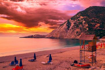 Sunset over Petani beach, Kefalonia island, Greece. View of Petani bay and beautiful beach, Kefalonia island, Greece.