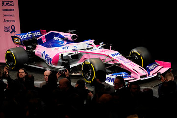 People take pictures after SportPesa Racing Point F1 Team drivers unveiled their team's new car livery at a pre-season launch event at the Canadian International AutoShow in Toronto