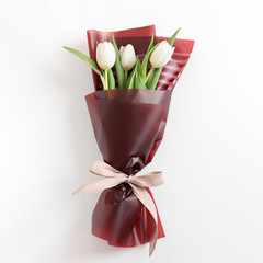 Spring flowers. Fresh tulips, bouquet in minimal style on light background. Top view, spring flat lay. Love and gift concept.