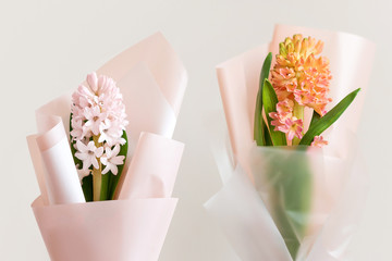 Spring flowers. Fresh bouquets with hyacinth in minimal style on light background. Top view, spring flat lay. Love and gift concept