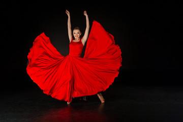Studio shot of beautiful european girl in red dress