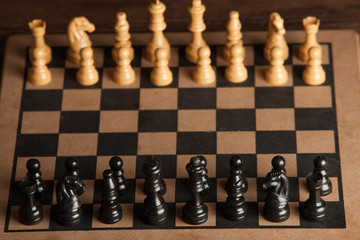 Chess board with chess pieces. Chess on the dark background. Business success concept. Strategy. Checkmate.