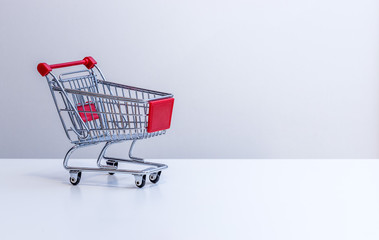 Sale: Shopping cart with copy space, grey