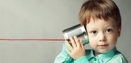 boy listen tin can telephone