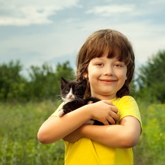 Happy kid with a kitten