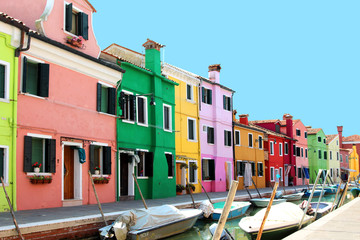 island of burano. Venice. Italy. island with bright houses. bright juicy rich photo with residential small colorful houses. pink, green, yellow, red house in Italy. unusual architecture. houses with f