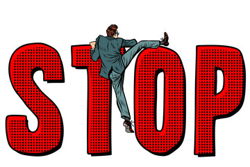 businessman man climbs on the word stop