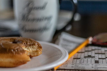 donut and crossword puzzle for breakfast