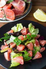 Healthy green salad with grapefruit, lose weigh food. Diet plan. Wooden rustic table.