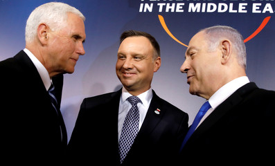 U.S. Vice President Mike Pence, Polish President Andrzej Duda and Israeli Prime Minister Benjamin Netanyahu talk during the family photo at the Middle East conference at the Royal Castle in Warsaw