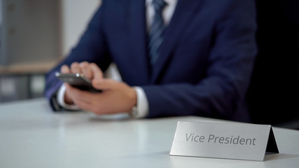 Company vice president using smartphone for communication, viewing files online Wall mural