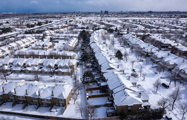 Aerial View of Roofs of Houses Covered with Snow