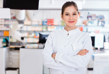 Portrait of woman pharmacist who is standing on her work place i