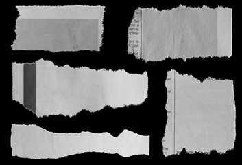 Torn papers on black