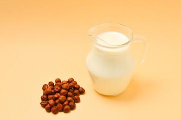 Hazelnut milk in a jar and nuts.