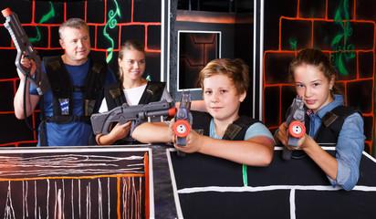 Teenage kids playing lasertag