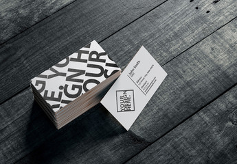 Stacked Business Cards on Wooden Surface Mockup