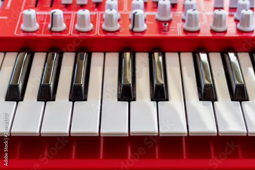 Midi keyboard synthesizer piano keys closeup for electronic