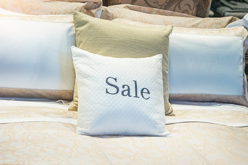 SALE - inscription on the pillow in the store of linen and furniture during the sale