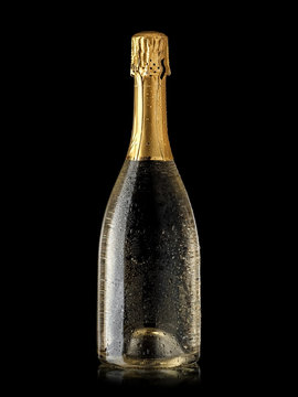 Full champagne bottle with drops