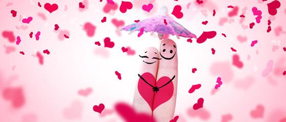 Zwei verliebte Finger mit Regenschirm