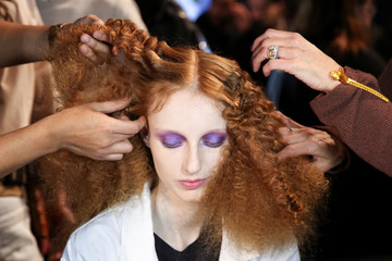 A model is prepped backstage at the Michael Kors collection runway show during New York Fashion Week in New York