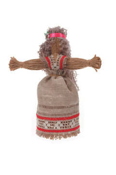Figurine of a woman with flowing hair with a red headband and beautiful dress with an ornament, handmade from jute thread isolated on a white background.