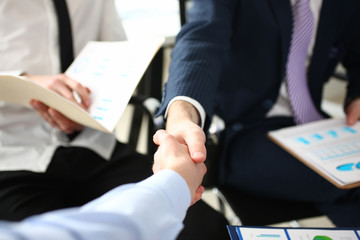 Man in suit and tie give hand as hello in office closeup. Friend welcome mediation offer positive introduction thanks gesture summit executive approval motivation male arm strike bargain concept
