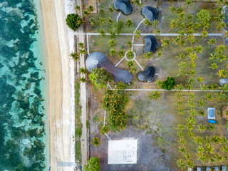Indonesia, West Sumbawa, Aerial view of Kertasari, beach and huts from above