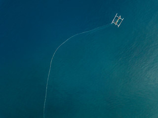 Indonesia, Bali, Amed, Aerial view of traditional boat and fishing net