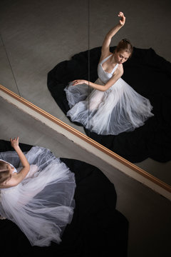 High angle view of ballerina reflecting on mirror while practicing in studio
