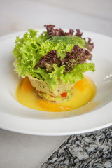 A portion of avocado salad with lettuce, fresh healthy vegetarian meal