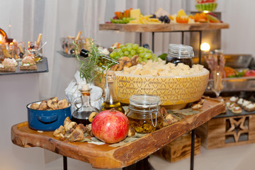 Buffet tray with fresh fruit, dry figs and cheese