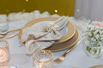 Golden napkin holder with olive branch