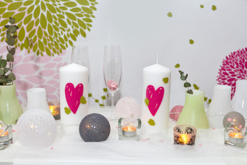 Romantic candles with hearts