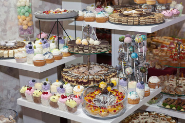 Cake pops and lollipops, colorful cupcakes, confectionery buffet