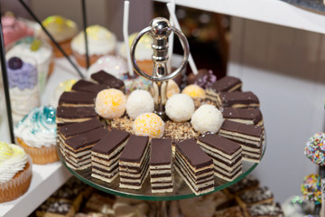 Layered chocolate cakes, confectionery buffet