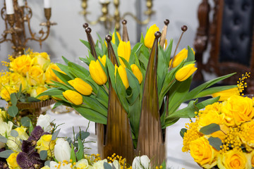 Crown shaped vase with yellow tulips