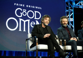 "Executive producer and show runner Neil Gaiman (L) and cast member Michael Sheen participate in a panel for the Amazon Series ""Good Omens"", during the Television Critics Association (TCA) Winter Press Tour in Pasadena"