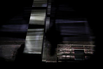 A shadow cast by a spotlight of a model walking the runway is seen projected onto the ceiling at the Marc Jacobs collection during New York Fashion Week in New York
