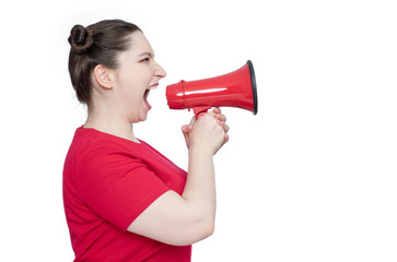 Young woman in red t-shirt screaming into a megaphone, side view, isolated on white background