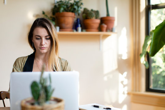 Relaxed woman working from home on her laptop