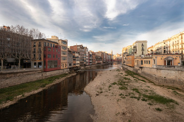 Girona skyline over a wide river with famous landmark cityscape in Catalonia